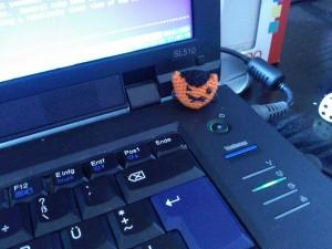 cat button on laptop